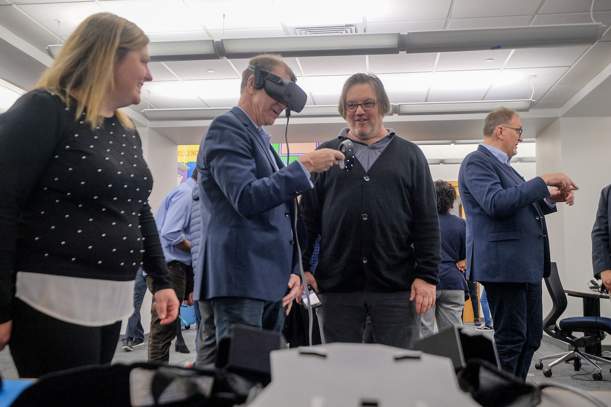 More guests immerse themselves into the VR world with the help of HP representatives. RIGHT: Another JSU student learns how to navigate through virtual reality with help from a fellow with the Center for Innovation. (Photo by Charles A. Smith/JSU)