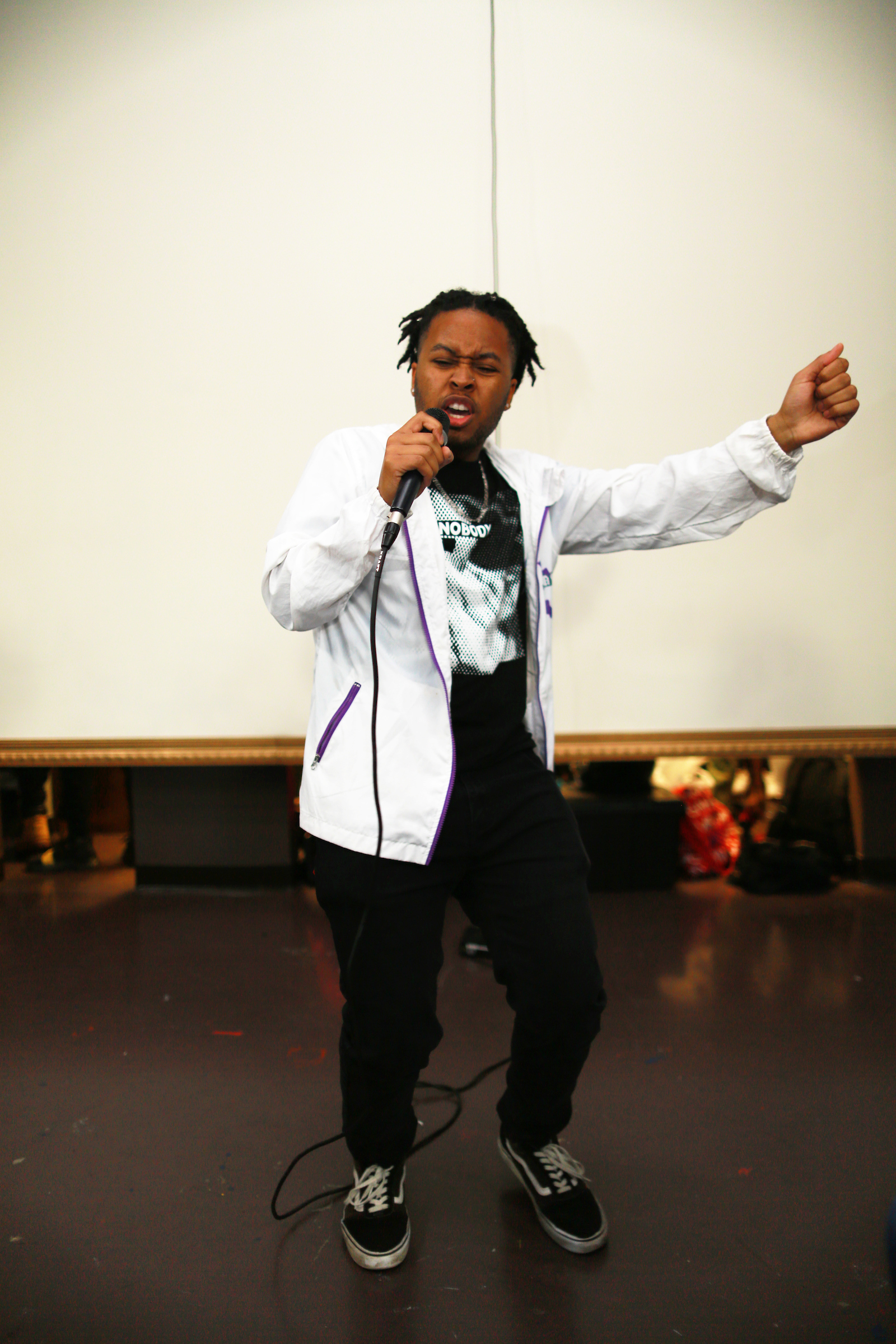 David Camper, a JSU student, who goes by the stage name Excalibur, gave attendees at the fashion show a taste of his rap performance. (Photo by William Kelly/JSU)
