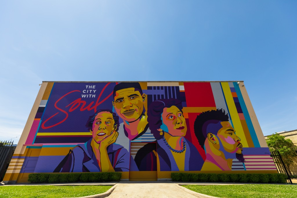 "Proud is how Reshonda Perryman says she felt when she finished painting the ""Jxn Icons"" mural. She hints that innovation, imagination, and a passion for artistry are the keys to her success. (Photo by Tate Nations.)"