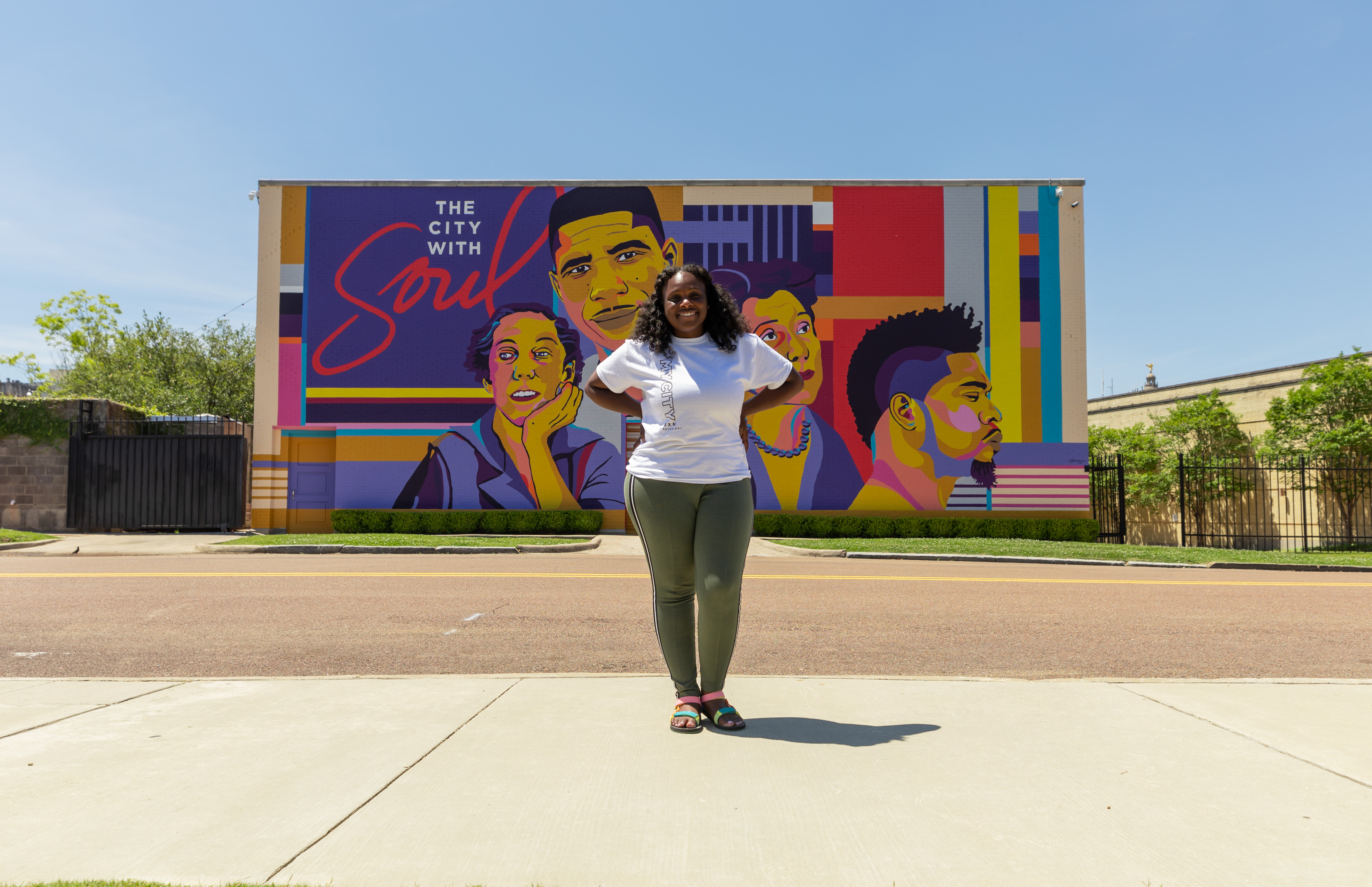 "Reshonda Perryman, 31, is an alum of Jackson State University and the creative designer at Visit Jackson. The organization wanted to celebrate four of the five Capital City mainstays. The ""Jxn Icons"" mural features Medgar Evers, Eudora Welty, Thalia Mara Mohoney and David Banner."