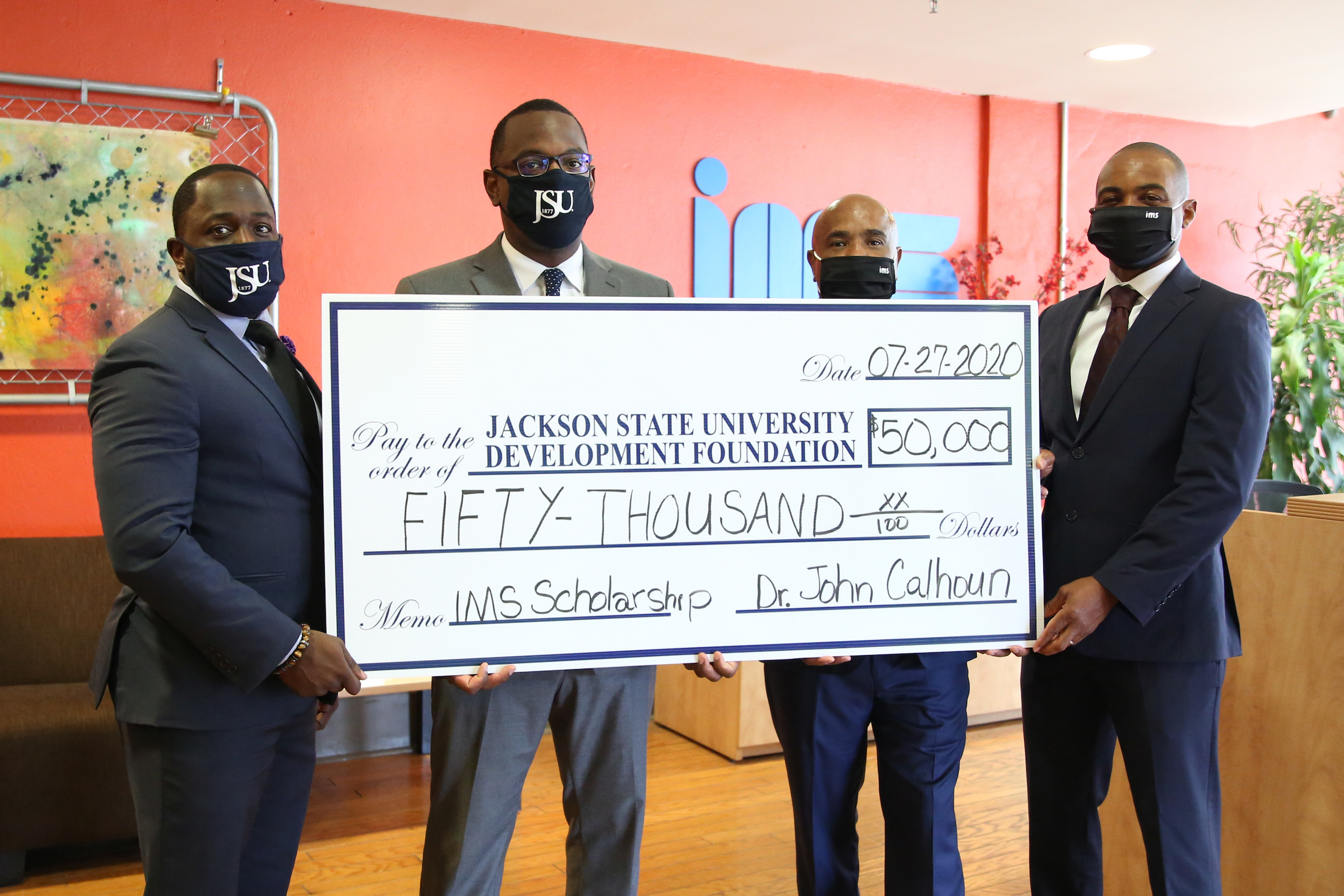 (Pictured from left to right)David Howard, research/program analyst for Division of Institutional Advancement, Thomas Hudson, Esquire, Acting President of JSU, Dr. John D. Calhoun, CEO of IMS Engineers and Rod L. Hill, COO and President of IMS Engineers.