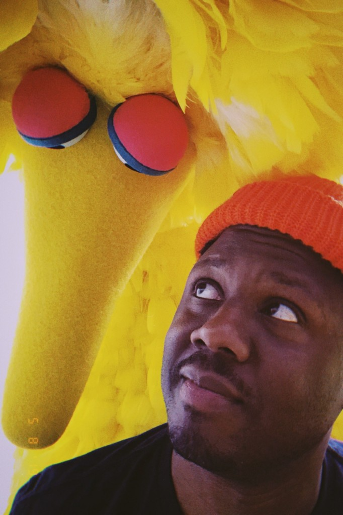 "Robert ""Bobby"" Carter shares an intimate moment with his childhood favorite, Big Bird of Sesame Street. (Photo special to JSU)"