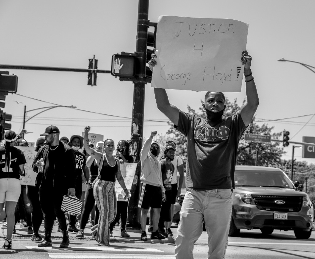 Christopher Calhoun, a rising junior at JSU, joins the Chicago-based march and displays his position in the social justice movement. (Photo by Wakil Atig)