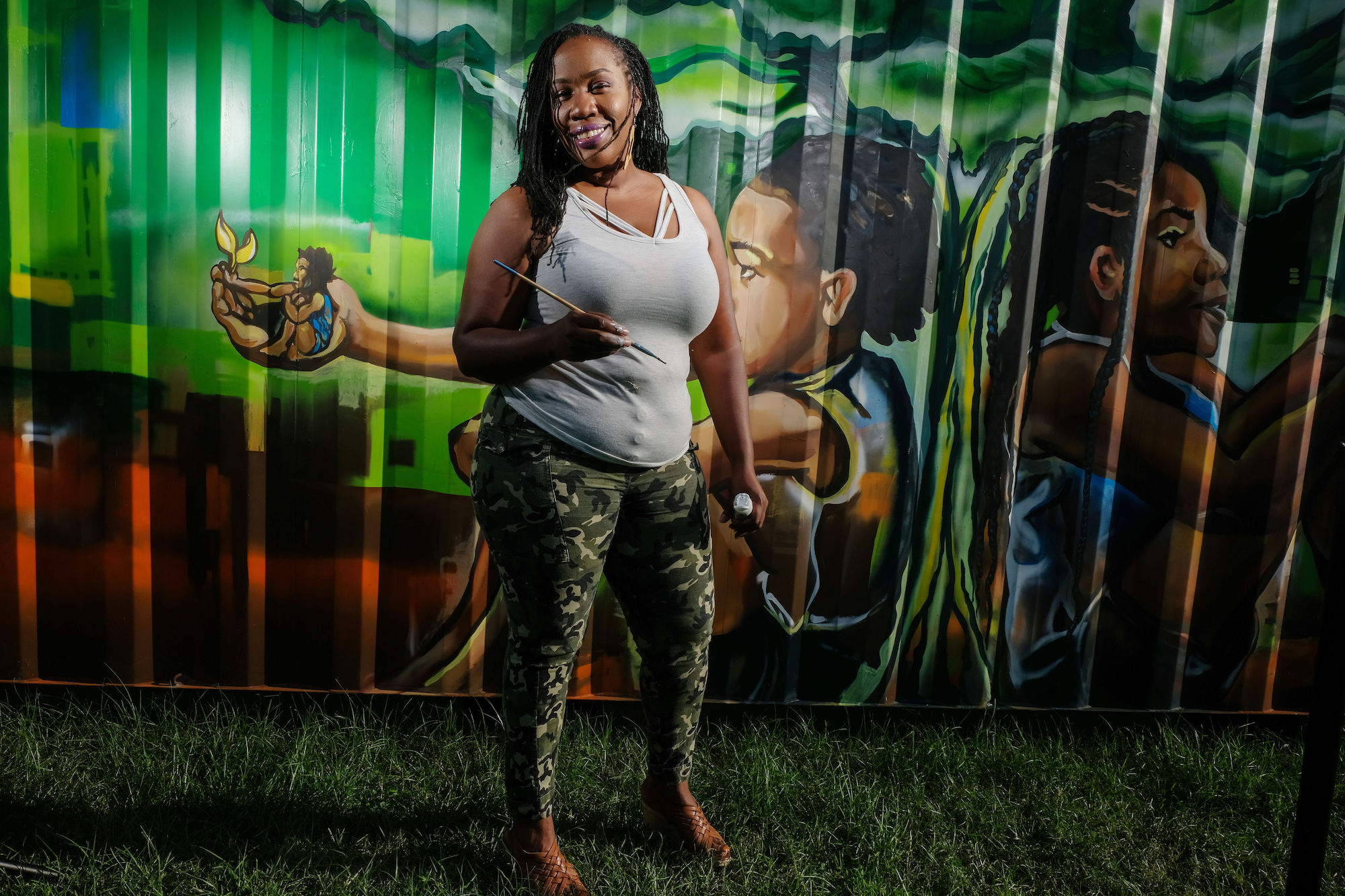 "Her mural ""Sowing the Seeds of Love"" spotlights generational growth. ""We can help change the world by what we sow into our children. The knowledge and tools passed down from generation to generation are necessary for sculpting our future,"" she said. (Photo by Charles A. Smith/JSU)"