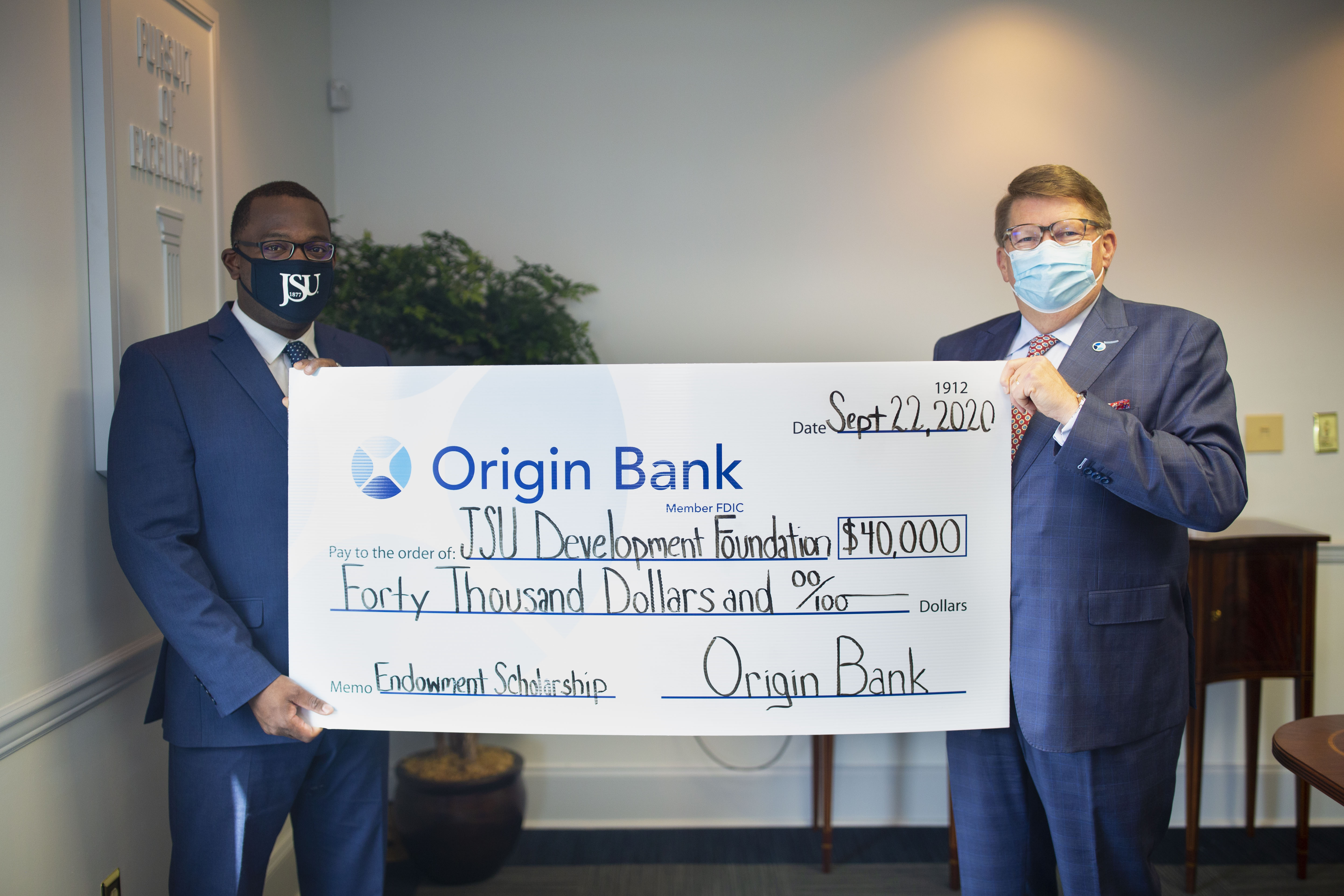 Origin's Bank State President, Larry Ratzlaff presented a check for $40,000 to JSU President Thomas Hudson for student scholarships. (Photo by William Kelly/University Communications)