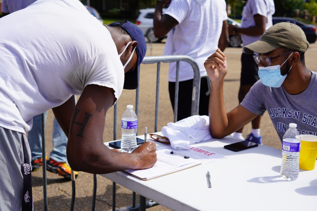 Students assisted their peers registering for the first time. (Photo courtesy of Division of Student Affairs)