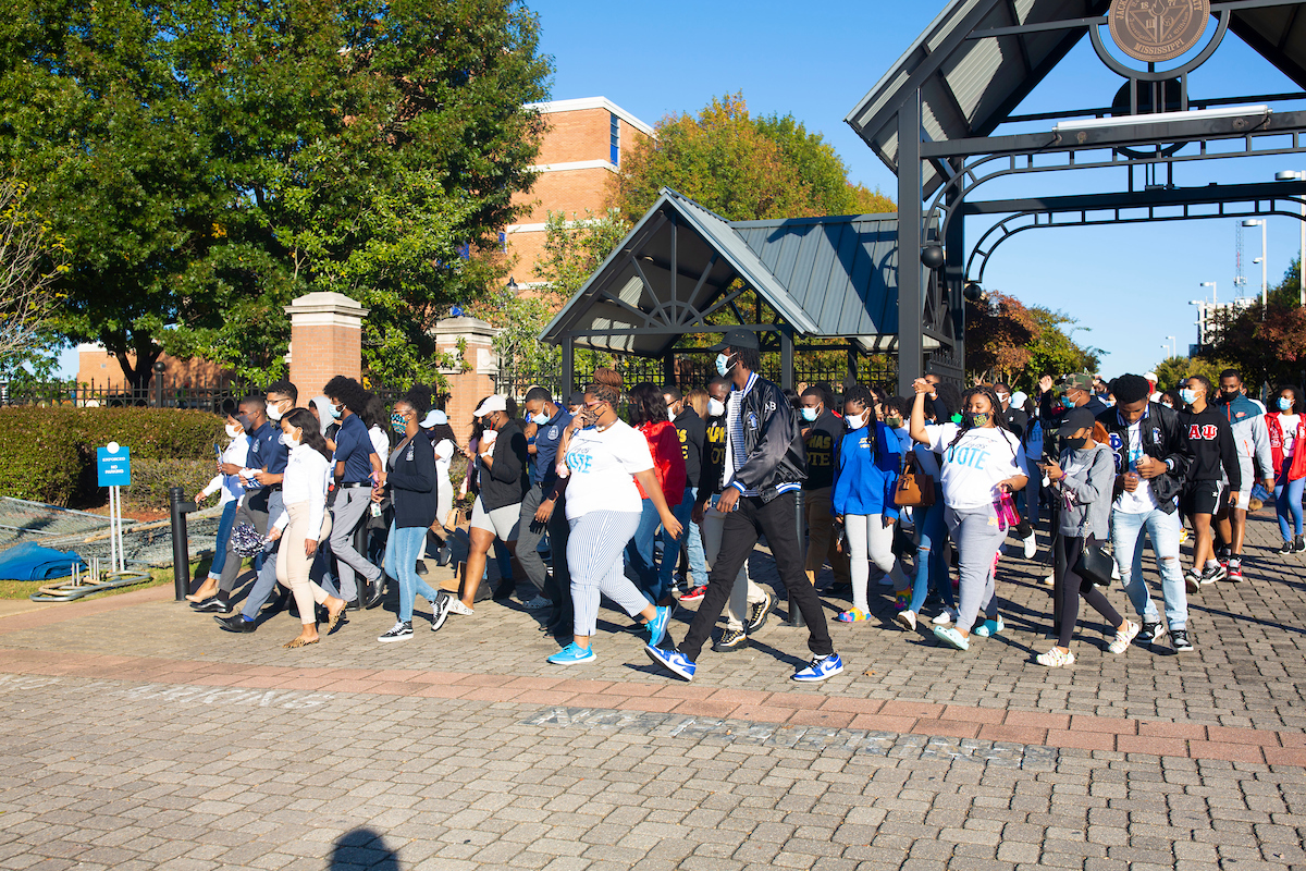 Leaving the Gibbs-Green Memorial Plaza, dozens of JSU students rustle toward the Lee E. Williams Athletics and Assembly Center to cast their votes on Election Day. The march was organized by the Student Government Association. (Photo by William H. Kelly III/University Communications)