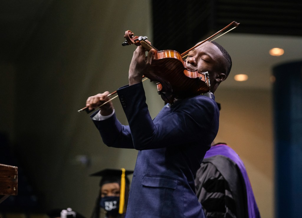 """Violinist John Eze Uzodinma II performed """"Total Praise"""" by Richard Smallwood. Other selections were """"Jackson Fair"""" (alma mater) and """"God Be With You."""" (Photo by Charles A. Smith/JSU)"""