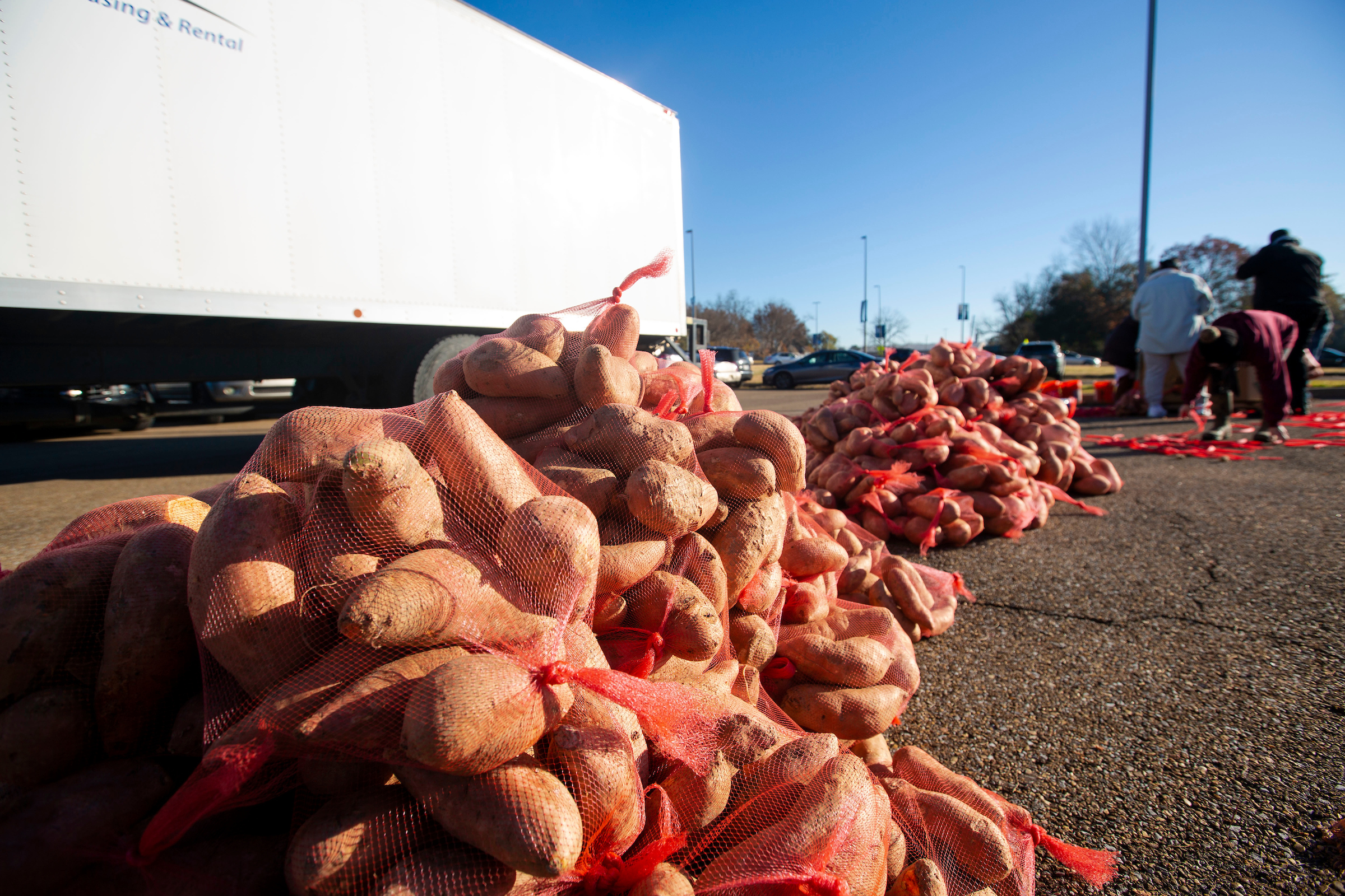 On Dec. 18, residents of West Jackson were treated to 15,000 sweet potatoes and fresh greens during the popular Crop Drop event hosted by JSU's Center for University-Based Development and the Society of St. Andrew. (Photo by William Kelly/JSU)