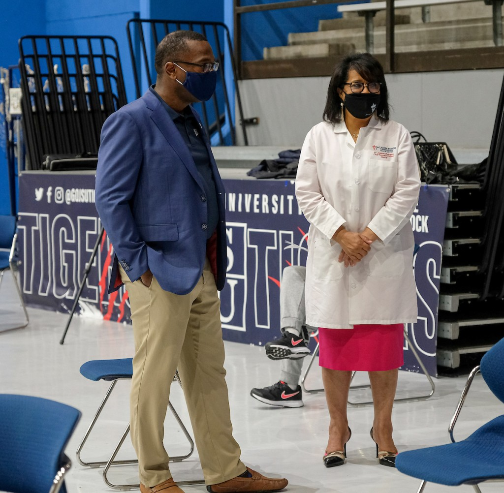 JSU President Thomas Hudson and Dr. Juanita Chapman, chief executive officer of the Jackson-Hinds Comprehensive Health Center, observe the vaccination site as students, faculty and staff file into the Lee E. Williams Athletics and Assembly Center. (Photo by Charles A. Smith/JSU)