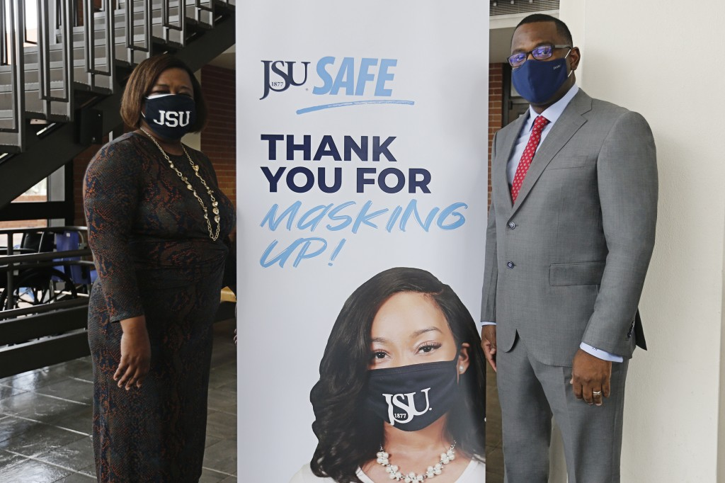 Thomas K. Hudson, president of JSU, and Dr. Alisa Mosley, provost and senior vice president of Academic Affairs, applaud JSU students for actively following the University's COVID-19 guidelines. (Photo by Charles A. Smith/JSU)
