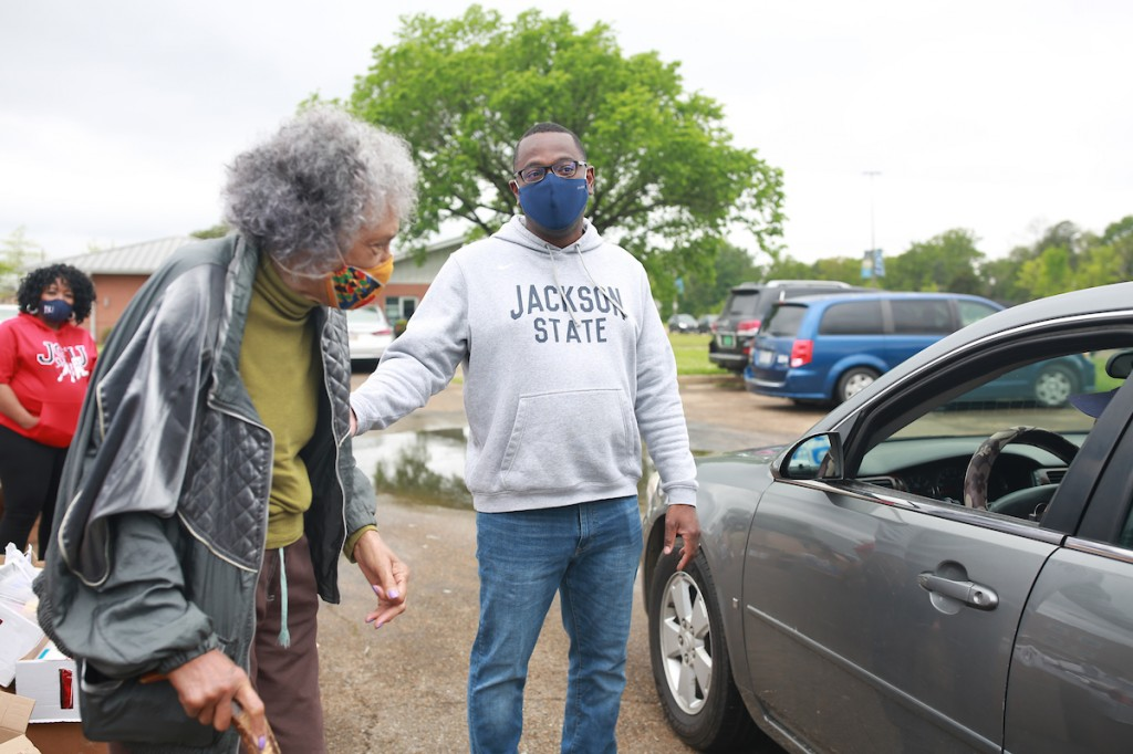 JSU President Thomas K. Hudson and state Rep. Alyce Clarke took part in the food distribution, encouraged volunteers and thank JSU and its partners. (Photo by William H. Kelly III/JSU)