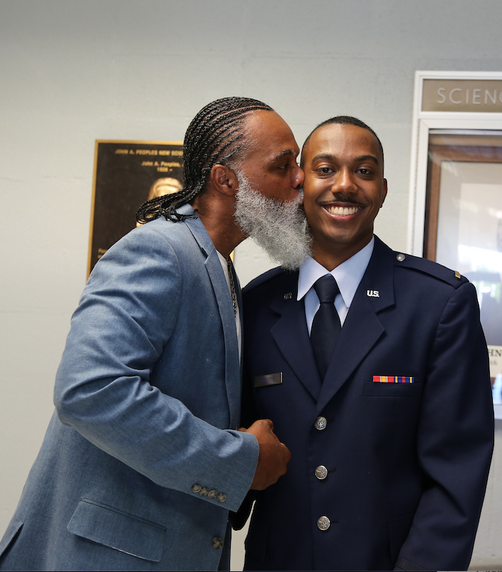 Newly commissioned 2nd Lt. Jalen McIntyre is congratulated by his father. (JSU Photo by Aron Smith/JSU)