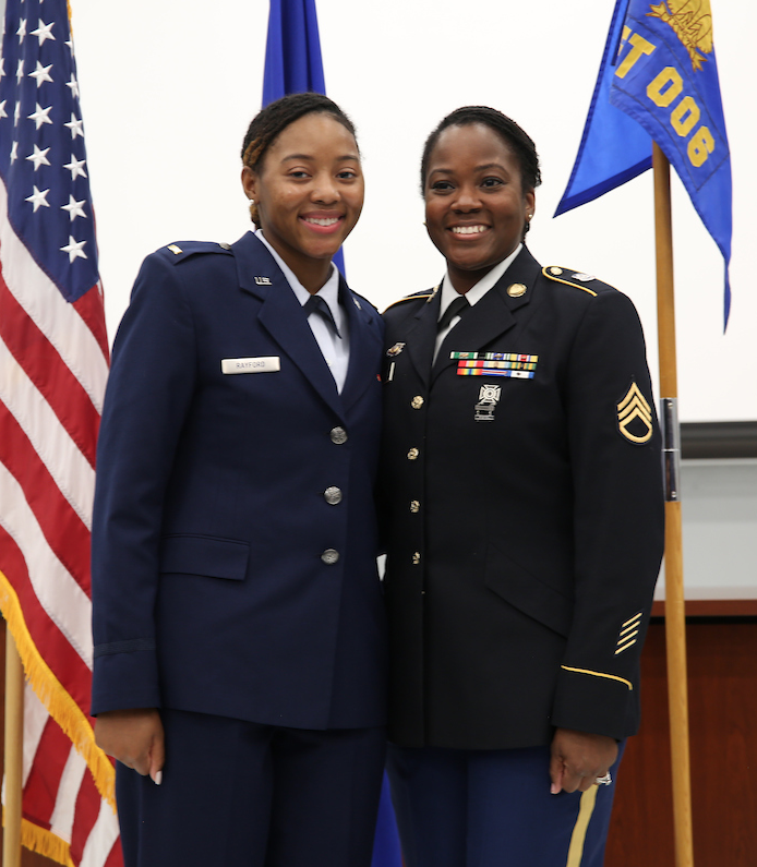 After earning her gold bar, 2nd Lt. Rayford, left, is honored by her aunt. (Photo by Aron Smith/JSU)