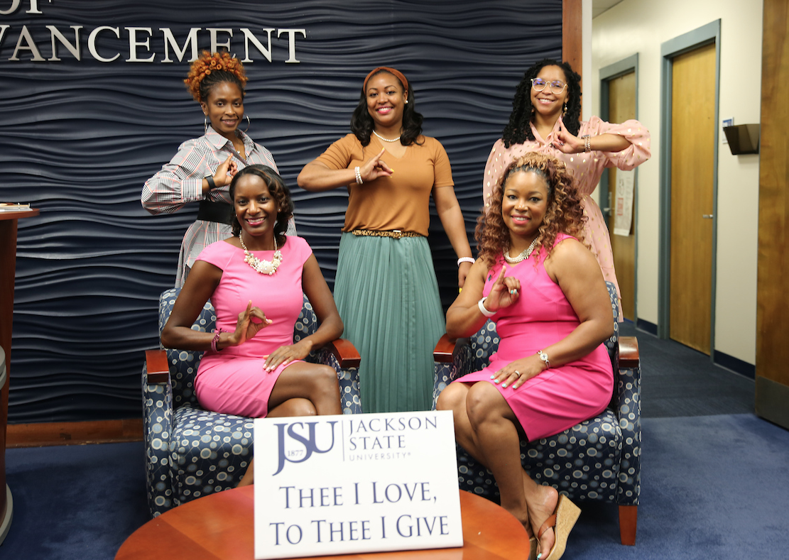 """Flanked by her sisters, Wade credits her sorority for helping her to """"realize the impact I can make."""" (Photo by Aron Smith/JSU)"""