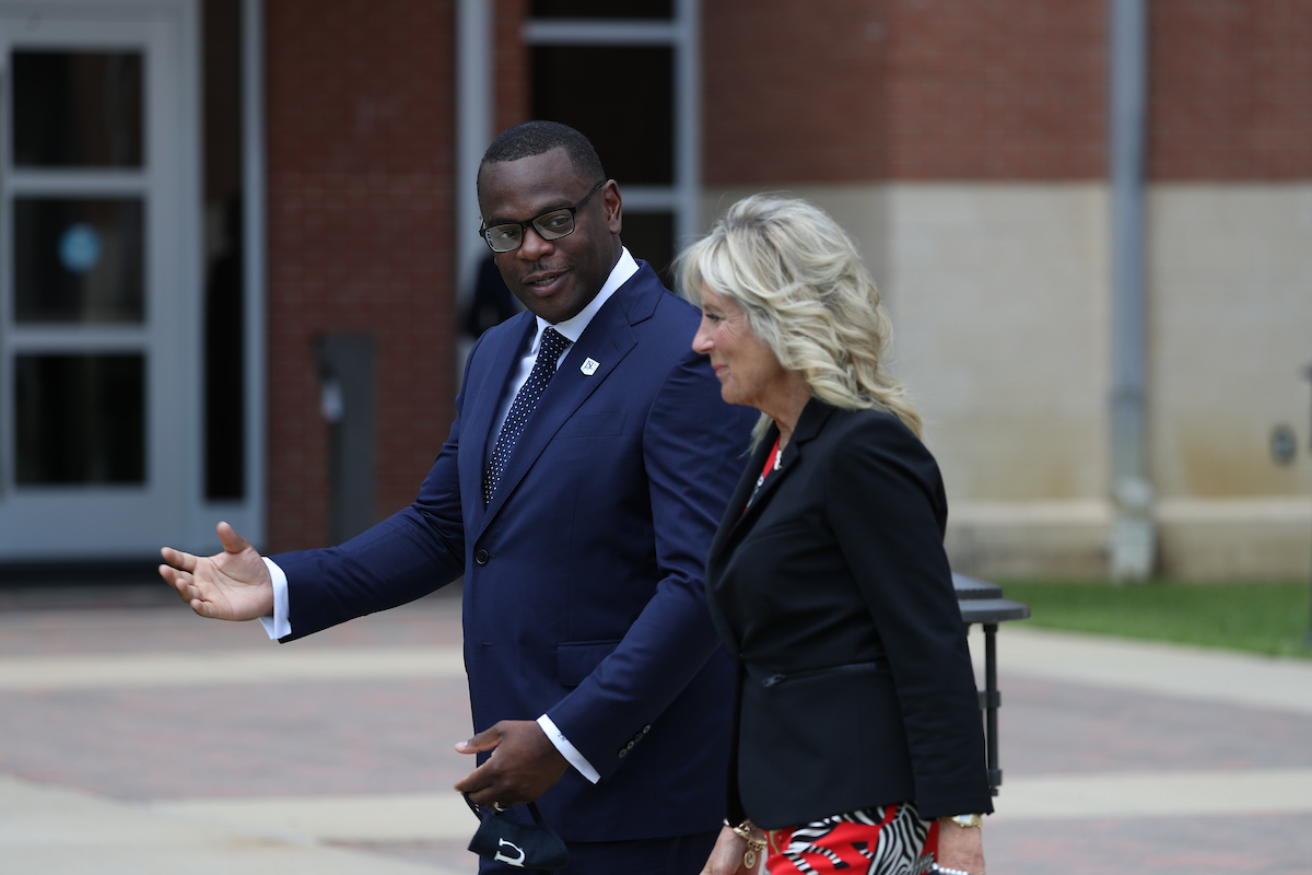 Jackson State University President Thomas K. Hudson greets and escorts first lady Dr. Jill Biden to the College of Science, Engineering and Technology building, where she would give remarks about the importance of COVID-19 vaccinations. (Photo by William H. Kelly III/JSU)