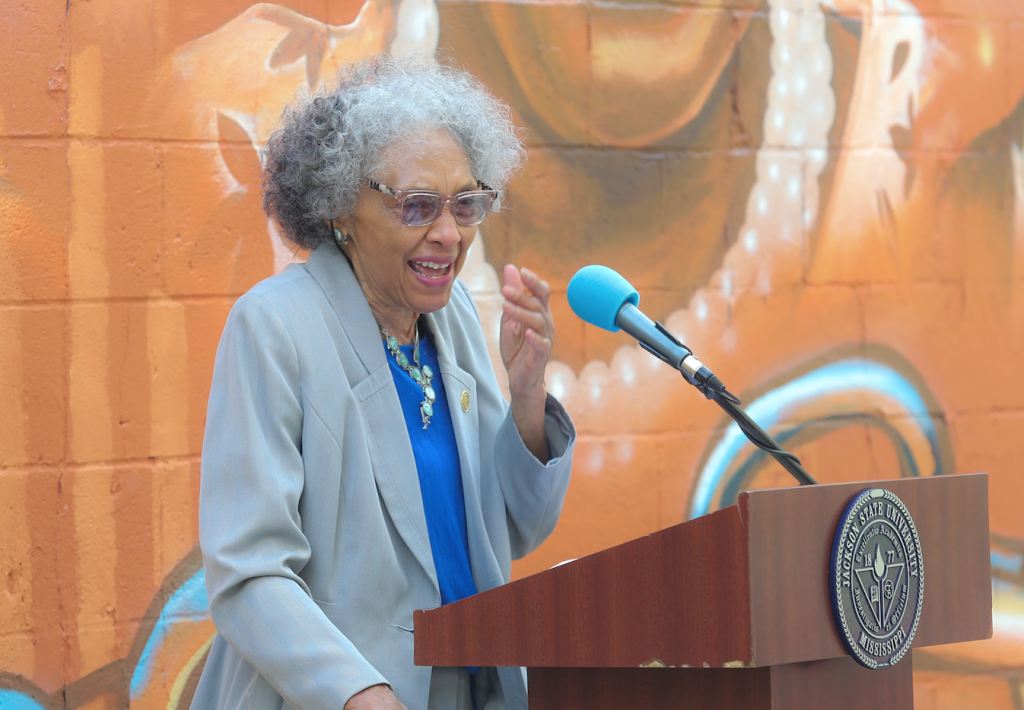 """Thrilled and slightly shocked, Rep. Alyce Clark, said, """"When I learned that I was being considered, I was blown away to know that they would consider me along with those other people they have on the mural.Have you looked at them and the kind of things that they've done through the years? To be among them on that wall, here in West Jackson, is such an honor."""" (Photograph by William Kelly, University Communications)"""