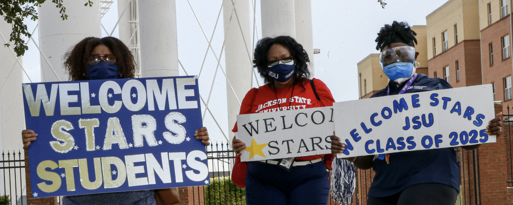 Students were welcomed by alumni with bright signs and creative chants. (Photo by Aaron Smith/JSU)