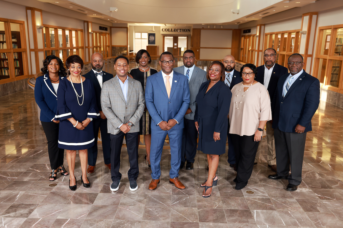 President Thomas K. Hudson (center) poses with the Jackson State University Executive Cabinet. Hudson announced that the cabinet is 100 percent vaccinated as an incentive to inspire the campus community to get the shot. (Photo by Charles Smith/University Communications)
